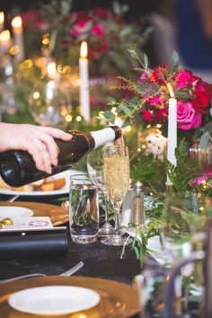 Mission Fete bubbles - The Chapel - black linen, gold charger plates, red florals with seed lights, Marquee canopy with fairylights by A Touch of Elegance - Beautiful head table of greenery, gold candlesticks, seed lights - florals and head table by Kerin Greville. With thanks to Rei Bennett Photography. Gold Chargers, Everything Is Possible, Charger Plates, Black Linen, Flower Wall, Candlesticks, Gold Wedding, Canopy, Greenery