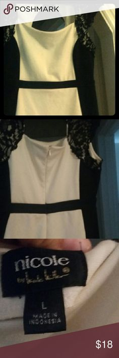 Nicole Miller Dress Size Large This dress by Nicole Miller is black & off white with lace detail. Knee length on me (5'4). The last picture shows a small stain of some sort. It is hard to see in the picture and also in person (however price reflects this). I wore this dress once for graduation. Nicole by Nicole Miller Dresses Midi