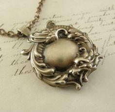 Vintage Dragon LOCKET Necklace Brass. $38.00, via Etsy.