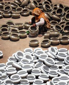 A Pakistani woman potter gives the final touches to earthen pots at a workshop on the outskirts of Lahore on June 9, 2011. (Arif Ali/AFP/Getty Images) From: 39 Stunning Images Celebrating Women Around The World