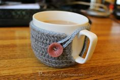 Crochet a cute mug cozy with this simple step by step tutorial!