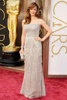 Brides.com: The Most Wedding-Worthy Red Carpet Dresses. Jennifer Garner at the 2014 Oscars. She stood by husband Ben Affleck's side throughout the 2013 awards season, but the Dallas Buyers Club star shone all on her own at the 2014 Oscars in this silver tulle tiered fringe Oscar de la Renta gown. Understated accessories and sleek wavy hair kept the focus on the sophisticated, perfectly bridal dress.  See more Oscar de la Renta dresses.