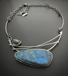 "SOLD OUT Sterling Silver Labradorite Necklace Handmade One Of A Kind Necklace   Sterling silver and Labradorite stone hand forged in rural Wisconsin by the metalsmiths at Wild Prairie Silver Jewelry... Joy Kruse and Kali Karnopp... each necklace is a one of a kind. Sterling silver chain is hand forged link by link... adjustable to 19 inches, chain can be any length per your request.  Titled ""To Begin Again""  ​ watch us make your jewelry every day http://www.instagram.com/wildprairiesilver or…"