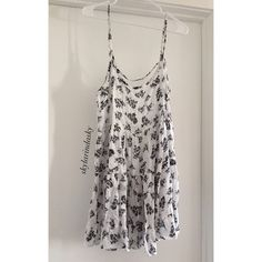 RARE print Brandt Melville Jada Dress Super cute black and white flowers. Rare print! In great condition. Prefer ️️ ❤️ Brandy Melville Dresses