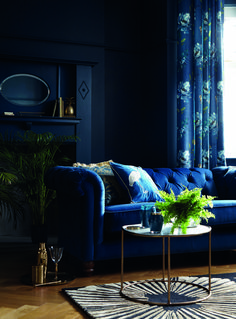 The Beauty of Blue In Your Home & How To Use It, from decor to lighting, top tips on how to use different types of blue in your homes.Navy being the darkest blue, provides you with an alternative to black in your homes. It has the same dramatic effect as black especially when applied to your walls. Add touches of metallics and pattern to lift it. #bluedecor #bluelivingroom #homedecor #moodyblues #blueinteriors #interiorinspo #livingroominspo #interiordesign #darkbluedecor