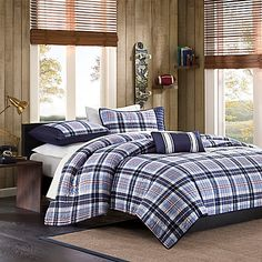 Bring a contemporary look to your bedroom with the handsome Mizone Eiliot Coverlet Set. Perfect for any young man's room, the modern bedding features a mix of light blue and dark blue plaid with a hint of red stripes.