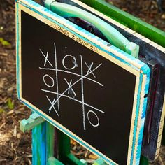 Super idea for your children's play room at home as well as for parties. Pick up an old TV tray set in a yard sale and do this creative makeover. Chalkboard Party Games