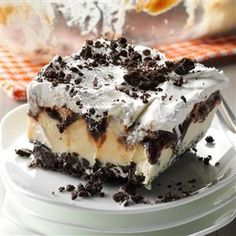 Ice Cream Cookie Dessert Recipe -Our family loves dessert, and this chocolaty, layered treat is one of Mom's most-requested recipes. It's so easy to prepare this Oreo ice cream cake! —Kimberly Laabs, Hartford, Wisconsin