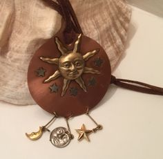 A personal favorite from my Etsy shop https://www.etsy.com/ca/listing/242525483/rare-huge-copper-sun-and-charm-dangles