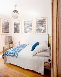 15 Bedrooms So Dreamy, You Won't NEED A Vacation #refinery29  http://www.refinery29.com/pinterest-worthy-bedrooms#slide-6  A brass bed frame with a quilt at the foot of the bed? Not one, but four framed art prints? #Goals.