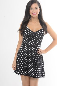 This black and white polka dot dress is perfect for day or night. With the fitted waist, flowing into a skater silhouette you won't have to look any further for the right dress. - Model is wearing a s