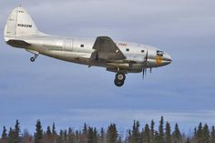 """Everts Air Fuel Curtiss C-46F Commando (CW-20B-4) (N1822M) nicknamed """"Salmon Ella"""" lands the Kenai Municipal airport, Alaska.   Everts Air Fuel operates several of the planes to deliver fuel and cargo around the state."""