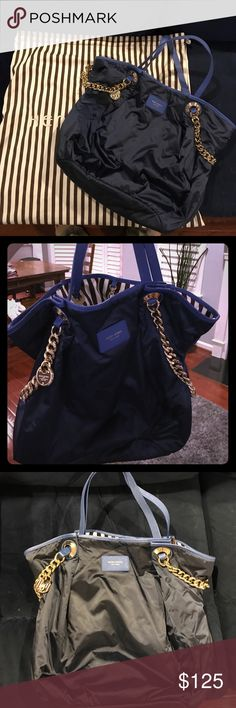 Henri Bendel blue satin tote Lightweight Bendel bag holds all!  Gorgeous Nanvy and blue with gold chains. Excellent condition. Pristine inside and out.  Fun bag!!  Many inside pockets. Straps are adjustable. henri bendel Bags Satchels