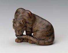 Tiger Licking Tail, netsuke by Tomokazu | Museum of Fine Arts, Boston