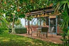 Patio with hot tub, outdoor dining, gas-fired BBQ grill and yard, ocean view