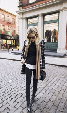 Long layers paired with fitted shirt and pants