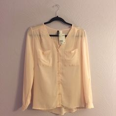 BUTTON DOWN BLOUSE ! Light pink button down blouse ! Sleeves can be down or rolled & buttoned up. Light material, never worn. Divided Tops Button Down Shirts