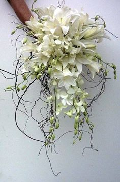 Bridal bouquet done with Madonna Lillies, Denrobium Orchids and Orchid Springs with Nuga roots.  Wedding Dreams Flowers - 077-3637101