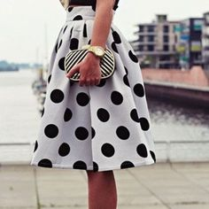 """Polka Dot Pleated Skater Skirt This skirt is beyond beautiful! Quality is amazing! It has a inside lining which creates that full skirt look. The elastic waistband in the back makes it comfortable and can fit a size Small to a Medium. Polyester material and measures 60cm in length. Waist 24""""-31"""" Skirts Circle & Skater"""