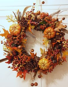 Hang wreath and continue to fill in while looking at it in a vertical position.  This is a very important step.  Because the wreath will be ...