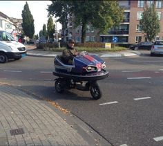 A man from my city mounted a carnival bumper car to his scooter