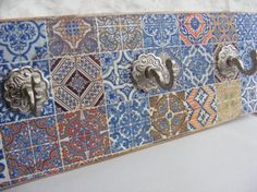 Check out this item in my Etsy shop https://www.etsy.com/uk/listing/519032017/spanish-moorish-style-three-hook-wall