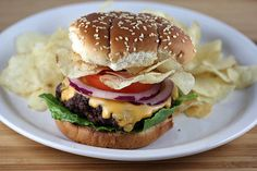 Crunchburger ~ This delicious burger is loaded with American cheese, lettuce, tomato, red onions, chips, and a horseradish sauce. Putting chips onto the burger gives it a really nice crunch.