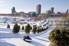 A young Reveller slides down a hill on the Plains of Abraham at the Carnaval de Quebec winter Carnival in Quebec City Wednesday February 13,...