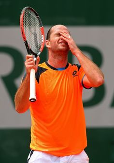 PARIS, FRANCE - MAY 26: Xavier Malisse of Belgium reacts during his mens singles match against Milos Raonic of Canada on day one of the French Open at Roland Garros on May 26, 2013 in Paris, France. (Photo by Julian Finney/Getty Images)