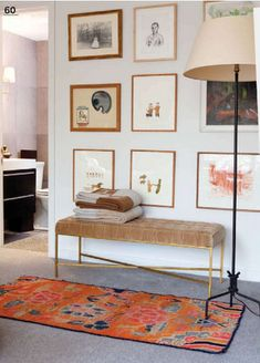 vintage brass bench and overscale floor lamp // gallery wall