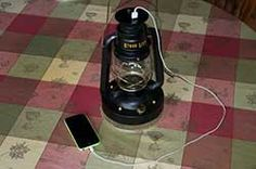 Stove Lite Charging Iphone with its built in battery that is charged off the heat of a wood stove.