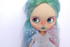 Im happy to introduce to you Losille. She is little and sweet unicorn girl and is looking her forever home! She is a Simply Guava doll customized by me, Custom dolls by Lego. She had the following work done: - her face up is done with pastels, watercolor pencils and professional acrylic colors (fixed with MSC UV CUT), - custom eyelids and new eyelashes, - new earrings, - sleepy eyes with new pull rings, - blogged eyes, - gaze correction, - 4 pairs of handpainted eyechips, - the backplate is…