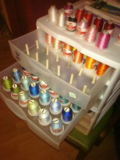 "Thread Storage Solution.  She used a scrapbook paper bin, hot glued cut 1/4"" dowels into each drawer."