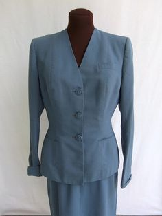Vintage 50s suit two piece (jacket and skirt) in dusty blue gray. V Neck, collarless, three button style. Long sleeves with turned back cuffs. Faux breast and front pockets. Fully lined jacket. Skirt is half lined on back only. Condition: Excellent vintage  Labels/tags: Hamilton Cincinnati  Size on tag: None Measurements of Jacket: ~Bust: 38 (armpit to armpit) ~Waist: 30 ~Hem: 39 ~Length: 24.5 ~Shoulder to shoulder: 15 ~Sleeve length (underarm): 19  Measurements of Skirt: ~Waist: 25 ~Hip...