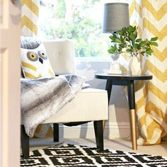 Mix patterns for a designer look, like these yellow chevron curtains and a black and white aztec rug seen here! Via our Instagram.