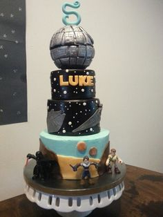 Star Wars cake complete with the Death Star, millennium falcon, star destroyer & Tatooine. Made by @Christin Cousins
