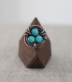 This ring is both beautiful and whimsical! Its perfect for Spring! In fact, the subtle markings in the howlite turquoise stones make them look like eggs hatching! Each ring will be slightly different. All images copyrighted Karisma by Kara Jewelry 2013