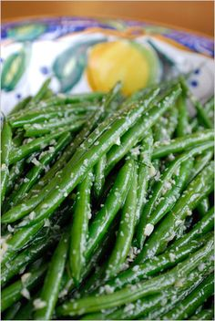 tosses string beans, a clove or two of minced garlic and lemon zest (along with a squeeze of lemon juice) in a pan, and sautés them with just a bit of olive oil.