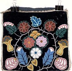 Ojibwe - Created: not later than 1900. Beaded cloth bag or pillowcase, features a black velvet section that was possibly originally an Ojibwe breechcloth