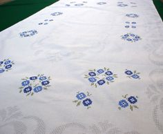 Vintage white cotton tablecloth with floral blue by Retroom, $26.00