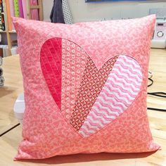 Sewing Pillows This pillow tutorial incorporates reverse applique and quilt-as-you-go techniques to make a perfect stitchy valentine. - Use reverse applique and quilt-as-you-go techniques in this valentine heart pillow tutorial. Applique Cushions, Sewing Pillows, Diy Pillows, Decorative Pillows, Throw Pillows, Patchwork Heart, Patchwork Cushion, Quilted Pillow, Applique Tutorial