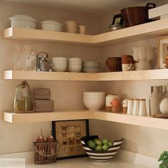 Open shelving provides easy-access storage in the kitchen.