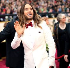 Oscar winner Jared Leto wore a Saint Laurent cream dinner jacket with a red bow tie and black pants. Jared Leto Oscar, Academy Awards 2014, Oscar Fashion, Luscious Hair, Man Bun, Celebs, Celebrities, Red Carpet Fashion, Guys And Girls