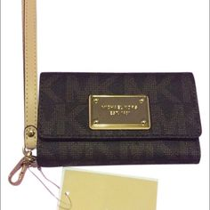 Michael Kors iphone 5 wristlet Michael kors Iphone 5 wristlet. Tags attached. Never used. 4 credit card slots. Slot for cash inside Michael Kors Bags Clutches & Wristlets