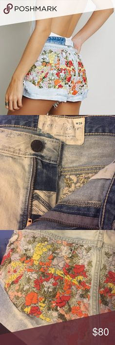 Free People - Elsa embroidered shorts WORN ONCE. High-rise denim cutoffs with distressing and intricately embroidered backs. Features hip pockets and a zip-fly with button closure. Free People Shorts Jean Shorts