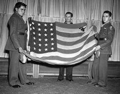 Holding the original Iwo Jima flag shown in the flag-raising photo made by AP staffer Joe Rosenthal, from left to right: Pvt. Ira Hayes, U.S. Marine Corp.; pharmacist's mate John H. Bradley, U.S. Navy; Pvt. Rene Gagnon, U.S. Marine Corp. All three, seen in New York, May 11, 1945, appear in the Iwo Jima photo. (AP Photo/John Lindsay) #