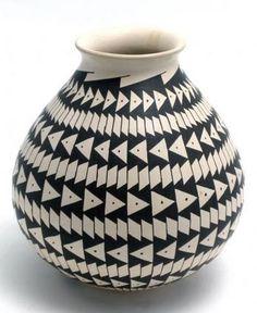 Mata Ortiz jar with repeating geometric designs. Painted black on cream slip. Signed by Jheri Mora.