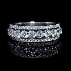 NEW: Three row diamond wedding ring featuring 54 round brilliant cut white…