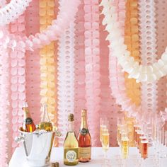 Design your own wedding back drop with paper streamers!
