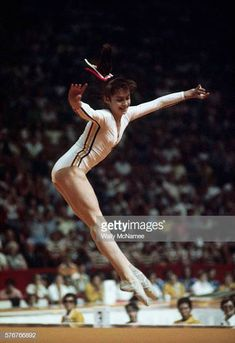 Nadia Comaneci of Romania performs on the balance beam during the allaround finals at the 1976 Montreal Olympic Games Comaneci received the first...